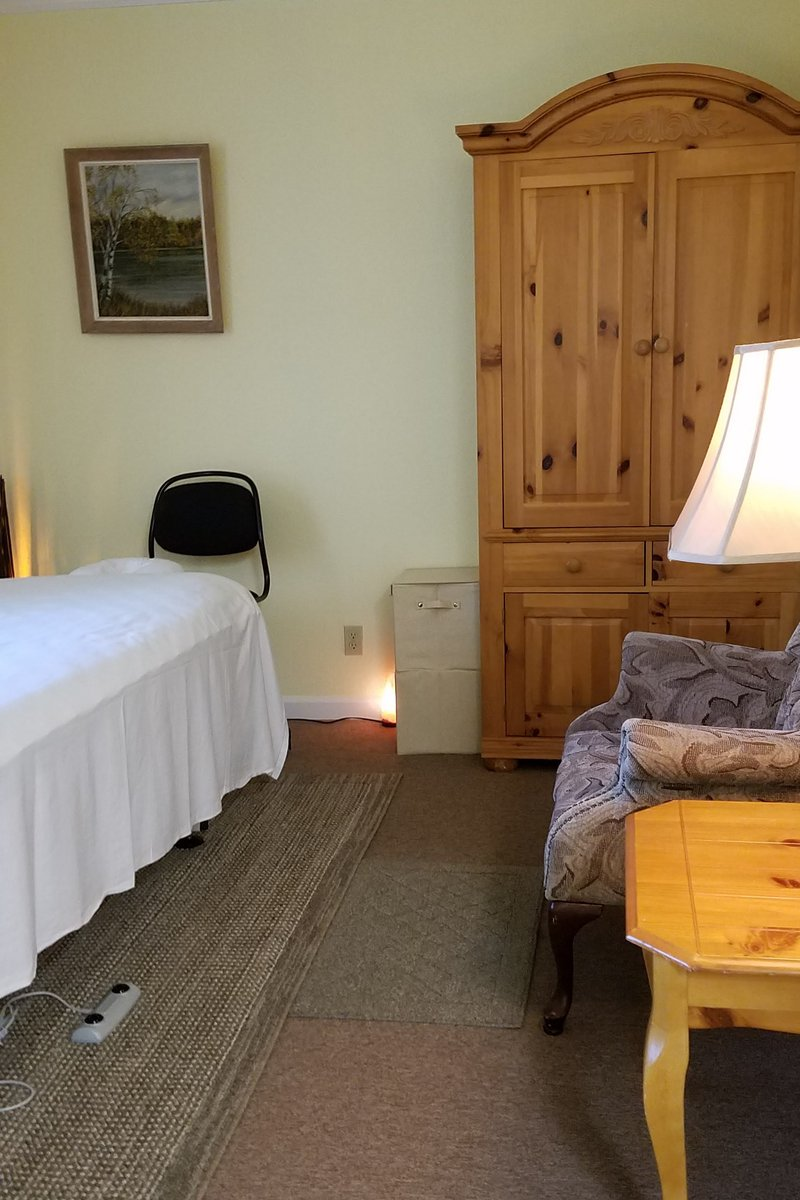 Massage room showing lighting and furnishings