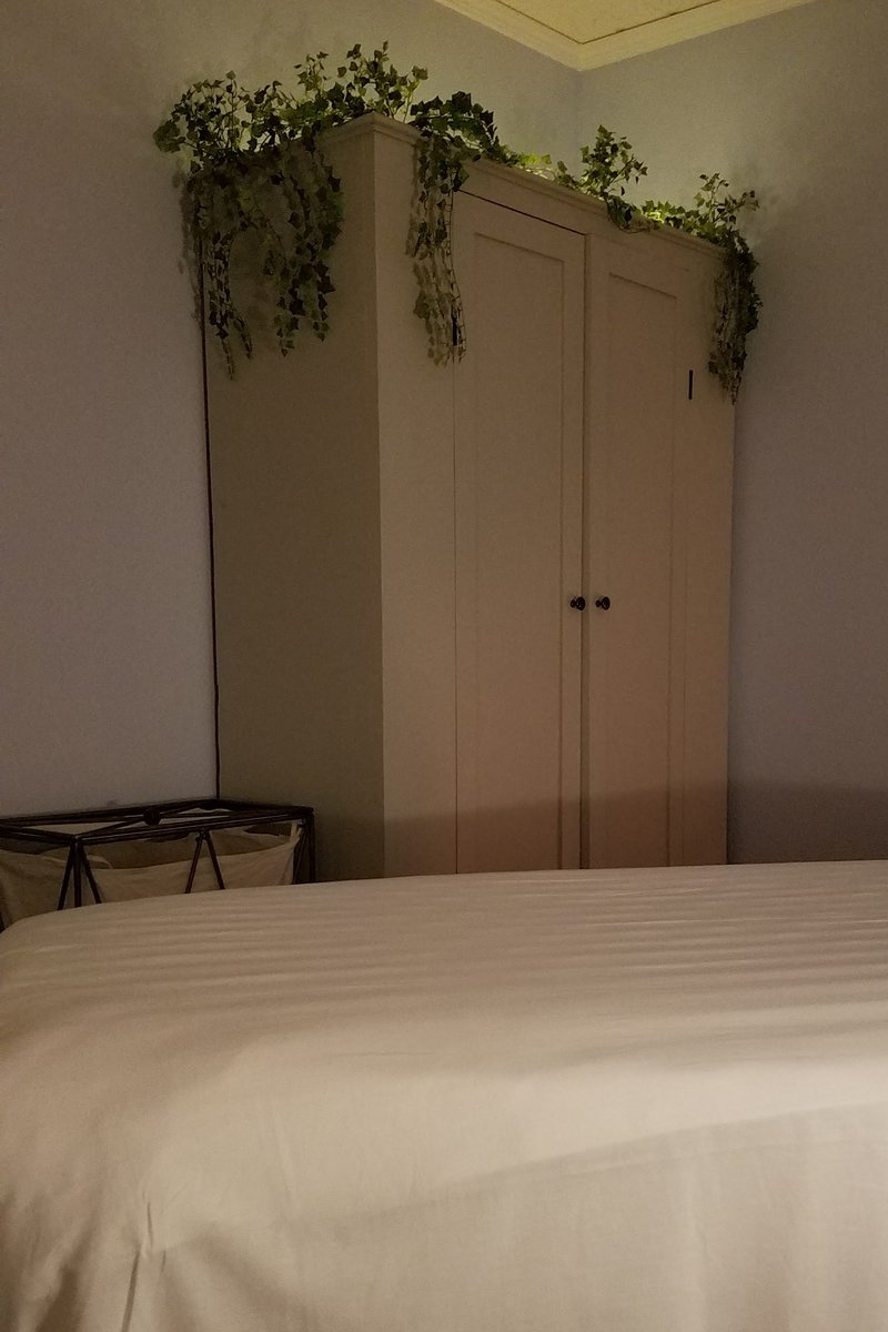 Decorated armoire in shared workspace massage room