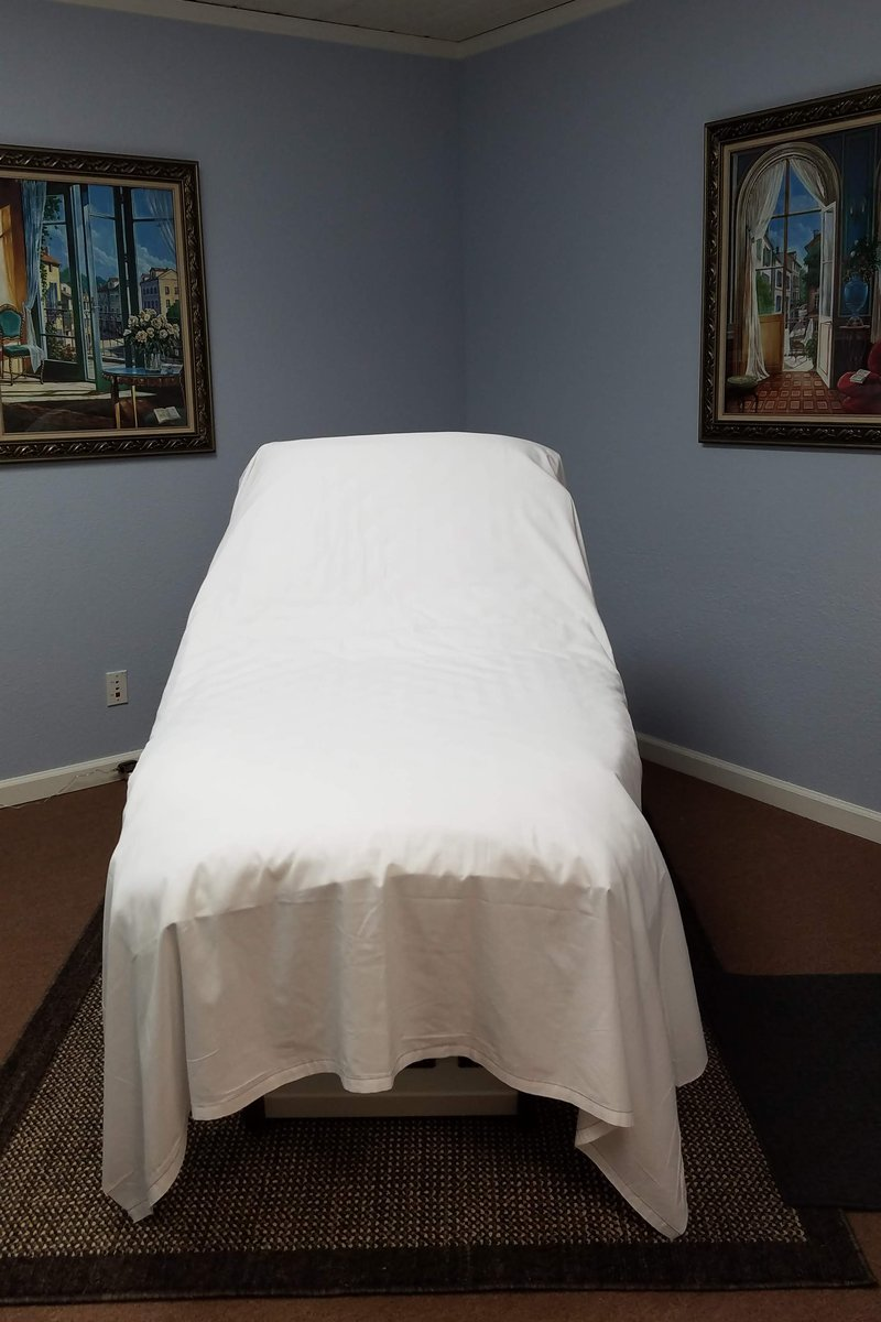 Massage table in shared workspace treatment room